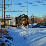 Freight trains dashing through snow to make up time lost