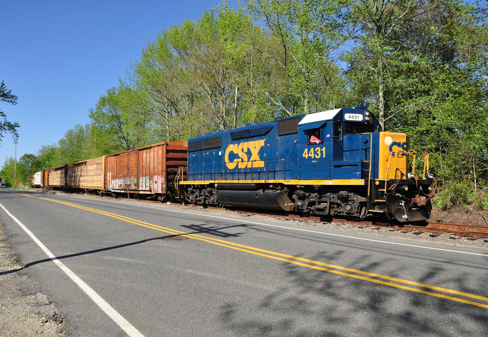 CSAO symbol SA31 bringing its small train through town on her way south to Lakewood, NJ.