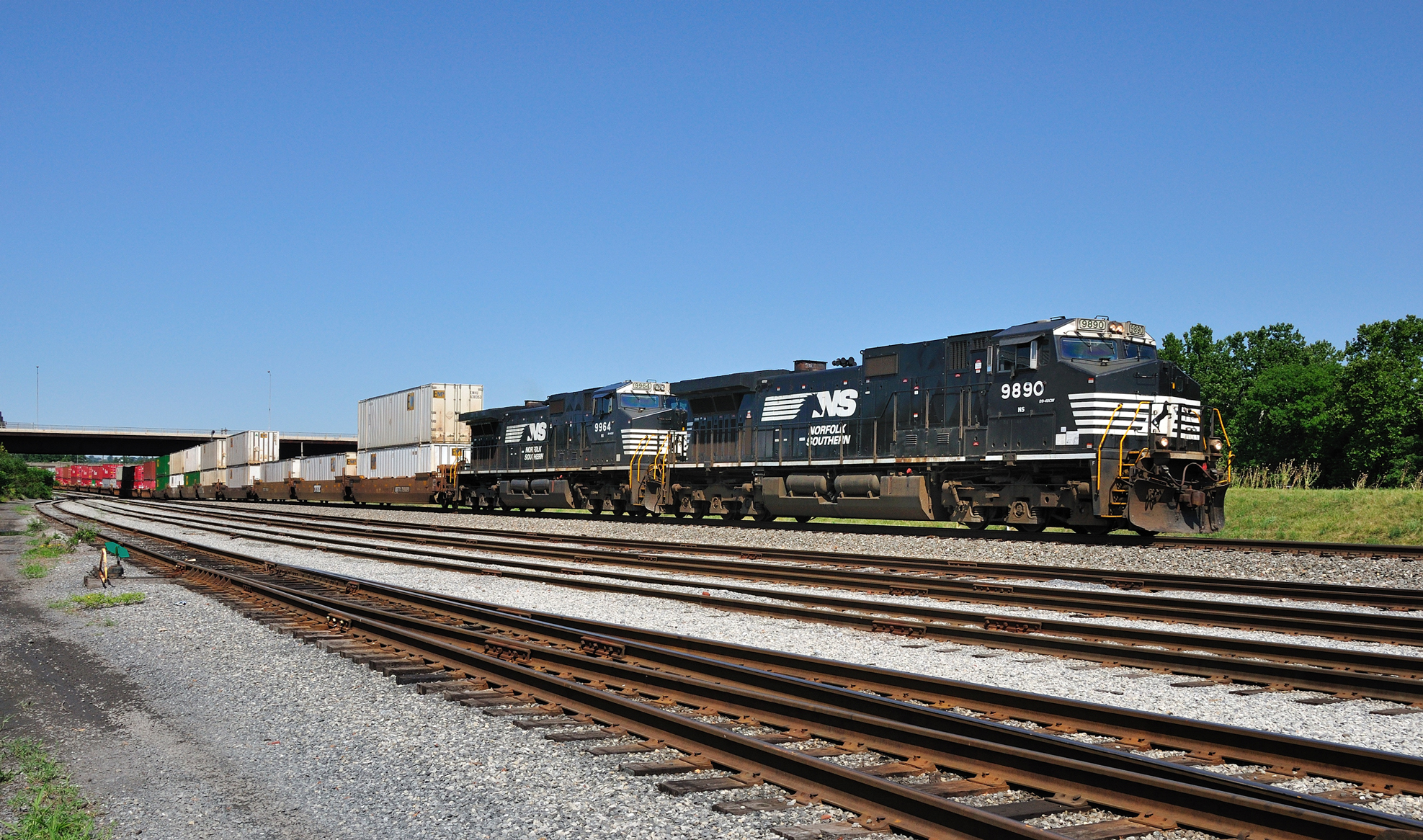 Train 22V speeds towards northern New Jersey, passing the small Norfolk Southern River Yard