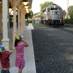 Kids cover their ears for locomotive's 5-chime air horn